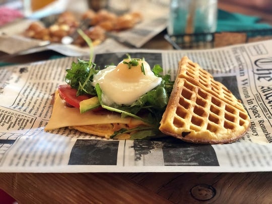 The Bullig Wafflewich from Bullig Coffee & Bites in Fort Myers, joins the restaurant's scratch-made waffles with bacon, cheese, tomato, avocado, arugula and a perfectly poached egg.