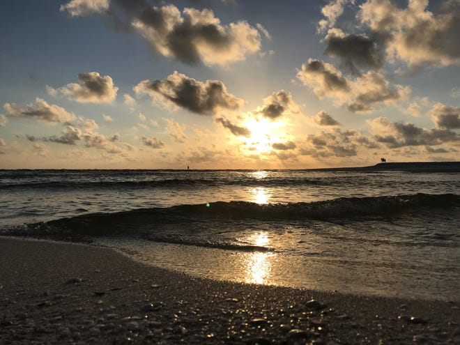 Naples Beach at sunset before the impacts of  red tide worsened.