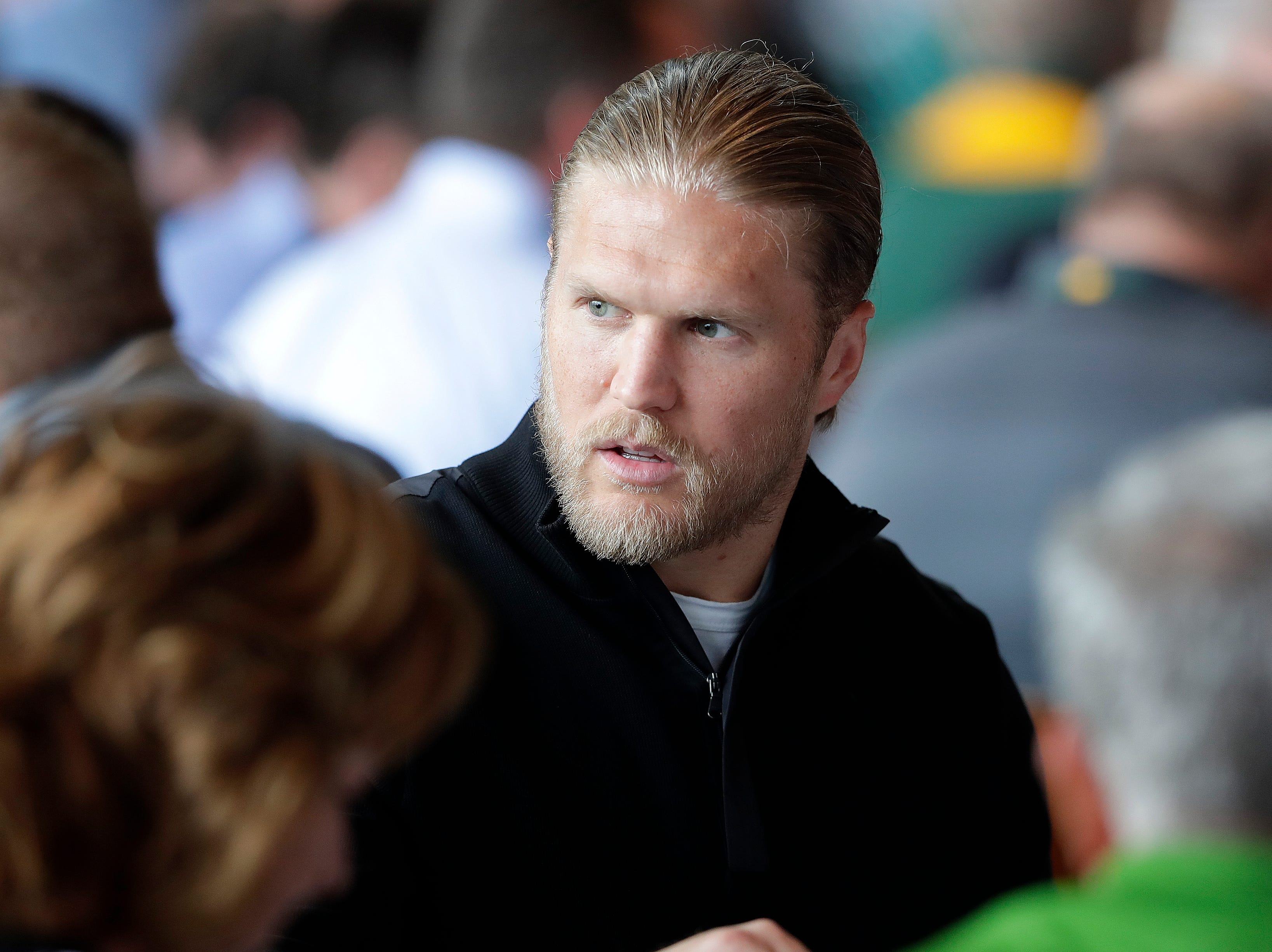 Green Bay Packers linebacker Clay Matthews (52) talks with tablemates during the Green Bay Chamber of Commerce Welcome Back Packers Luncheon at Lambeau Field Wednesday, August 29, 2018 in Green Bay, Wis.