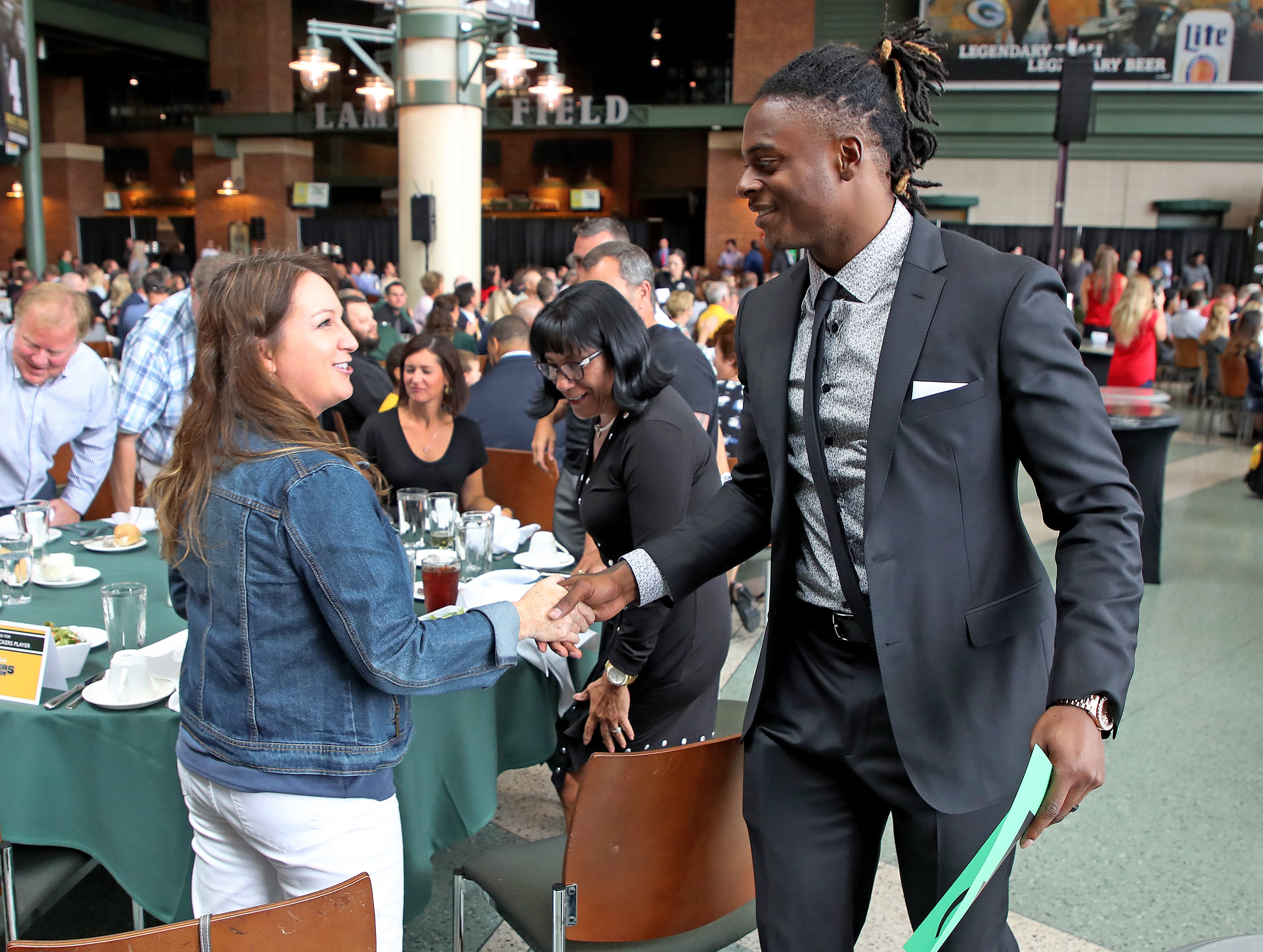 Green Bay Packers wide receiver Davante Adams (17) greets people at his table during the Green Bay Chamber of Commerce Welcome Back Packers Luncheon at Lambeau Field Wednesday, August 29, 2018 in Green Bay, Wis.