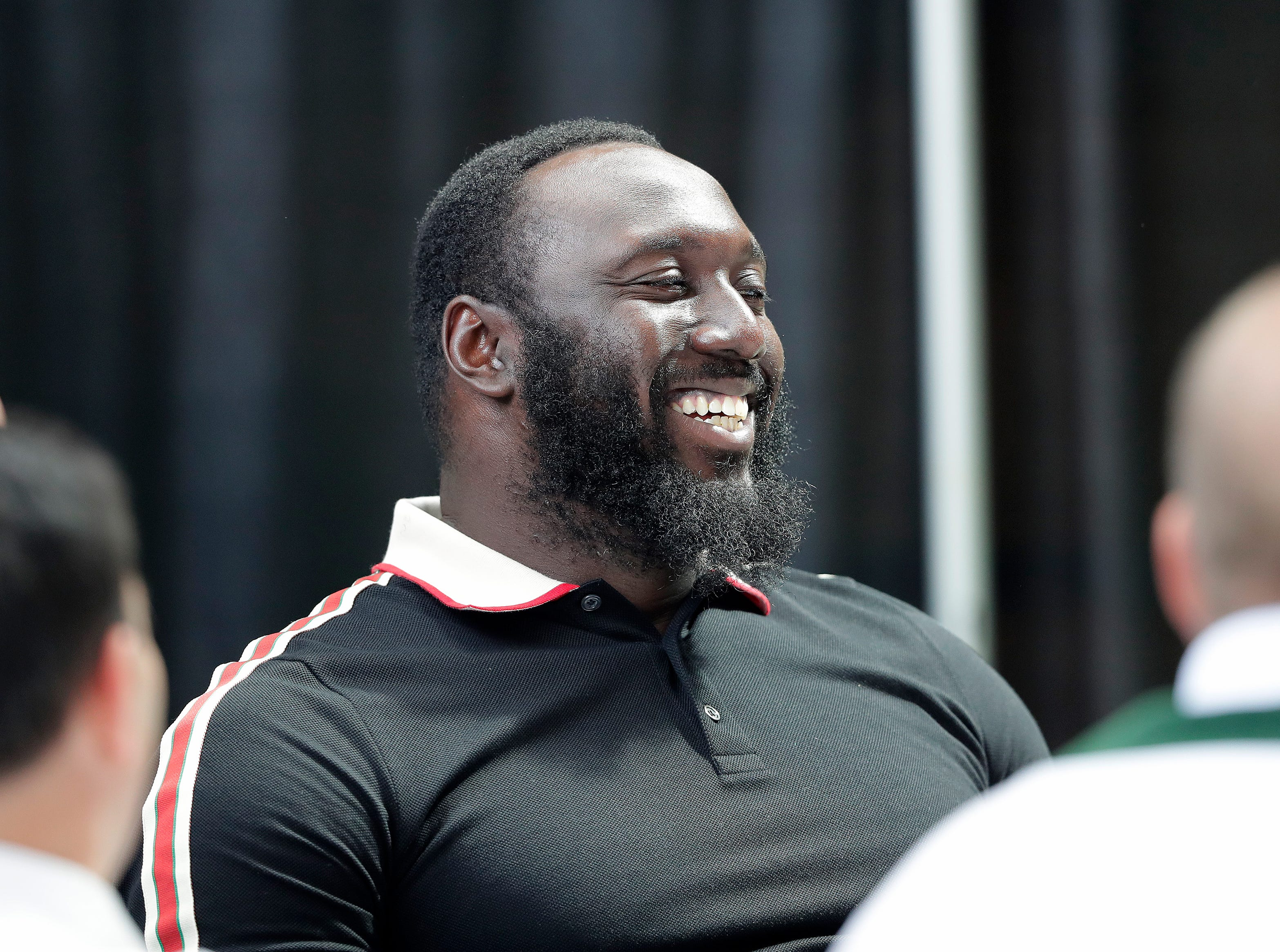 Green Bay Packers defensive end Muhammad Wilkerson (96) laughs during the Green Bay Chamber of Commerce Welcome Back Packers Luncheon at Lambeau Field Wednesday, August 29, 2018 in Green Bay, Wis.