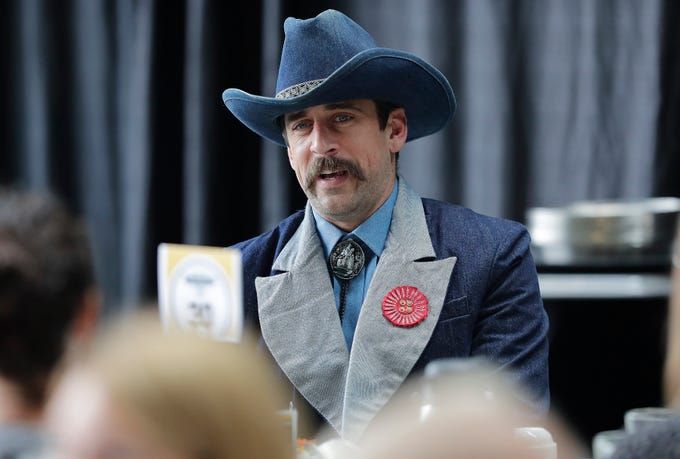 Green Bay Packers quarterback Aaron Rodgers (12) talks at his table during the Green Bay Chamber of Commerce Welcome Back Packers Luncheon at Lambeau Field Wednesday, August 29, 2018 in Green Bay, Wis.