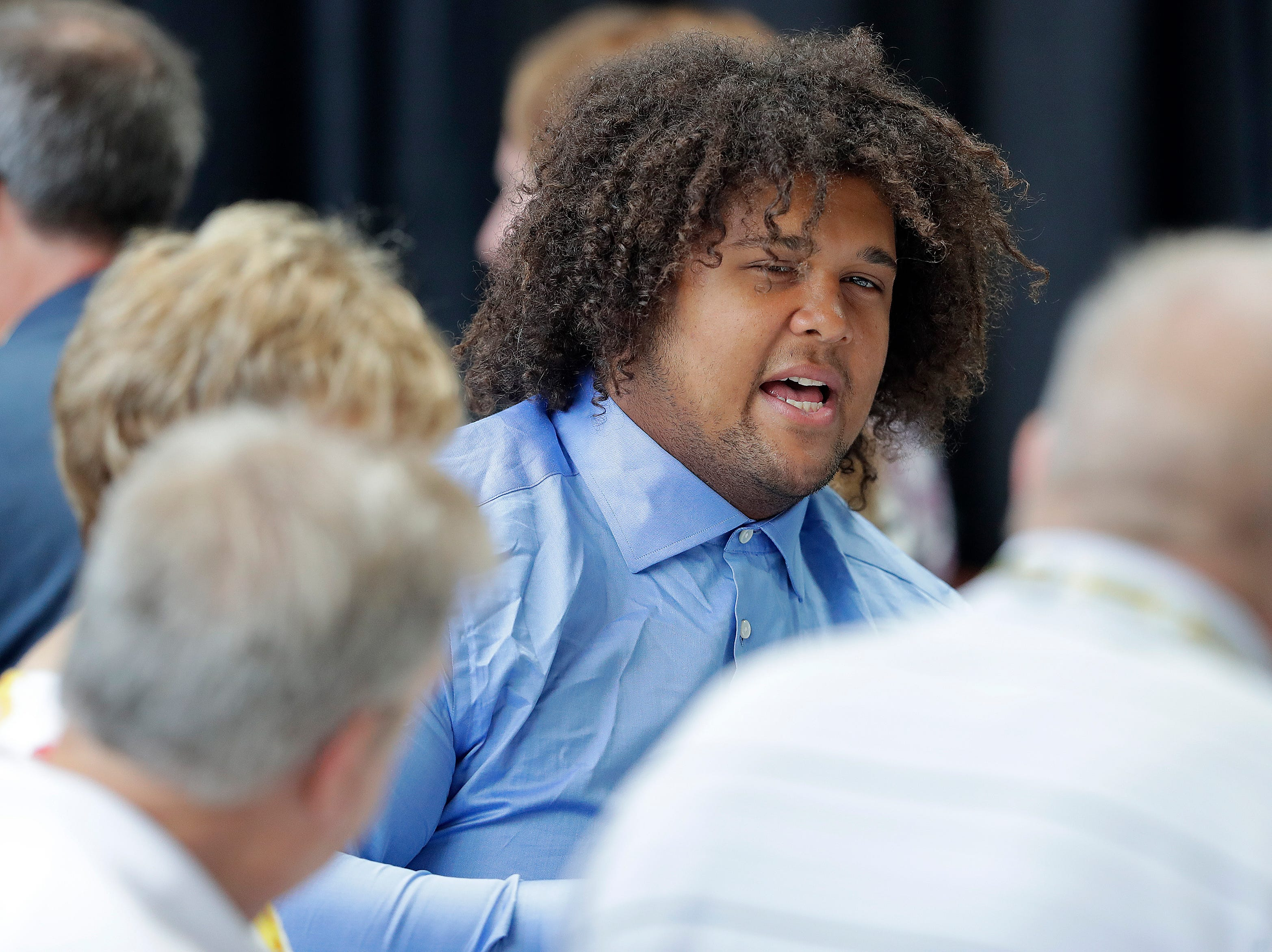 Green Bay Packers defensive end James Looney (99) chats during the Green Bay Chamber of Commerce Welcome Back Packers Luncheon at Lambeau Field Wednesday, August 29, 2018 in Green Bay, Wis.