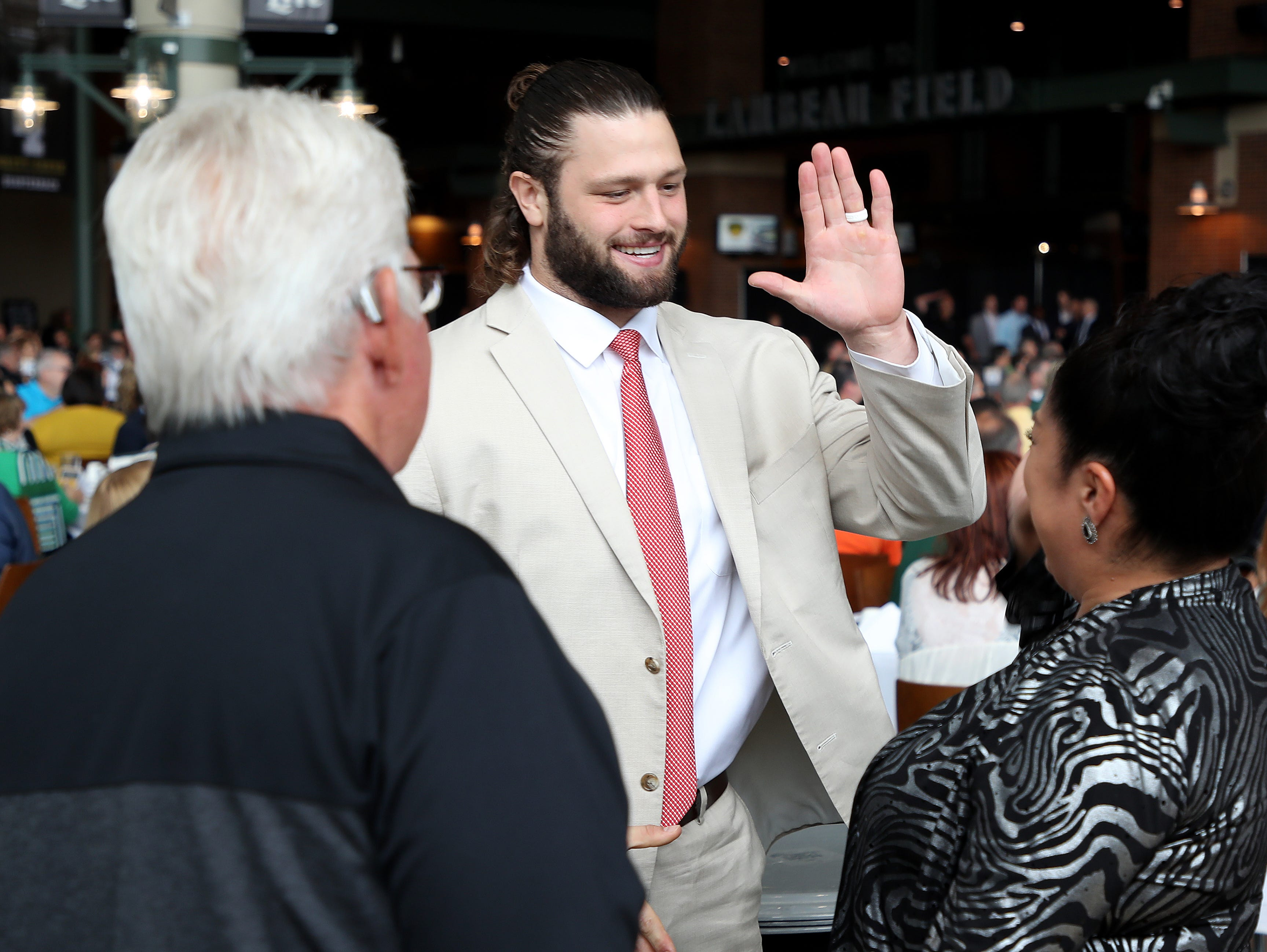 Green Bay Packers linebacker Vince Biegel (45) greets his table during the Green Bay Chamber of Commerce Welcome Back Packers Luncheon at Lambeau Field Wednesday, August 29, 2018 in Green Bay, Wis.