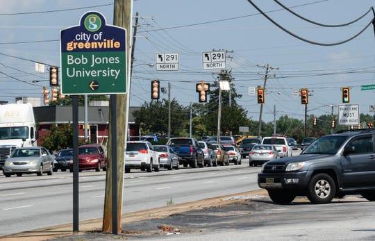 Traffic moves along North Pleasantburg Road near Bob Jones University, crossing State Highway 29, Wade Hampton Boulevard, in Greenville.