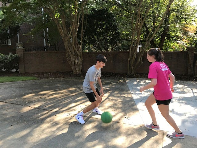 Harrison and Emma Grace Jimenez play basketball at their home in Greer. Their parents don't allow them to watch TV during the week as a way to encourage them to be active.