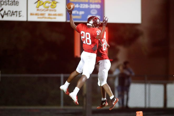 Hillcrest's Malik Eldridge, left, and A.J. Hill celebrate a touchdown during the Rams' 20-14 win over Mauldin Friday night. Hillcrest moved up to No. 6 in this week's rankings.