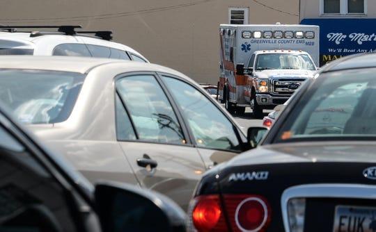 A Greenville County ambulance drives along North Pleasantburg Road near Bob Jones University, crossing over 29, Wade Hampton Boulevard, in Greenville.