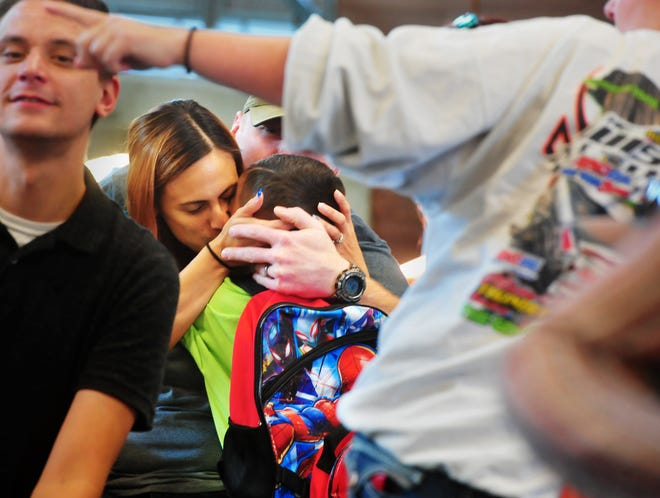 Kindergartner Declan Avery hugs his mother, Stephanie Scott, goodbye on the first day of school at Giant Springs Elementary on Wednesday morning, August 29, 2018.  Students from Roosevelt, Lincoln and Morningside Elementary Schools make up the student body at Giant Springs, which is Great Falls' first new elementary school since 1970.
