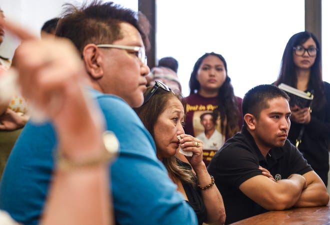 Parents, Andrew and Rosie Akima, and their elder son, Randy Akima, listen to details of the search conducted and recovery of their son and brother, Xavier Akima, during a briefing with Guam Fire Department officials in Hagåtña on Wednesday, Aug. 29, 2018. Xavier Akima, 15, lost his life after drowning in a flash flood, created by heavy rains, while he and eight others were hiking in the area of San Carlos Falls on Aug. 11.