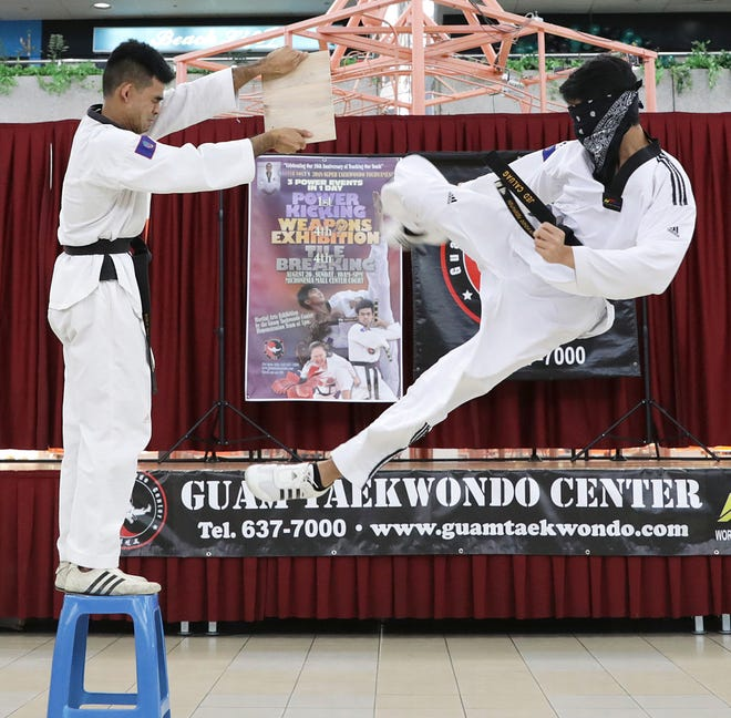 In thius file photo, Jed Caluag, a fourth-degree black belt, performs a tornado kick while blindfolded during the opening ceremonies of the 2018 Master Noly's Super Taekwondo Tournament at the Micronesia Mall. His father, Noly Caluag, has taught 40 to 50 students how to break boards and do spin jumps at the Guam Taekwondo Center during the COVID-19 pandemic.