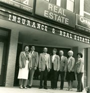 The owners and staff of Collier & Lackey Insurance and Real Estate, some in their new Century 21 gold jackets, pose outside their Main Street office in 1980. They include, from left, Mabel Collier, her son Jim, Jim Thornton, Mid Rankin, Jack Collier, Marlene Ballance and Lynda Peters.