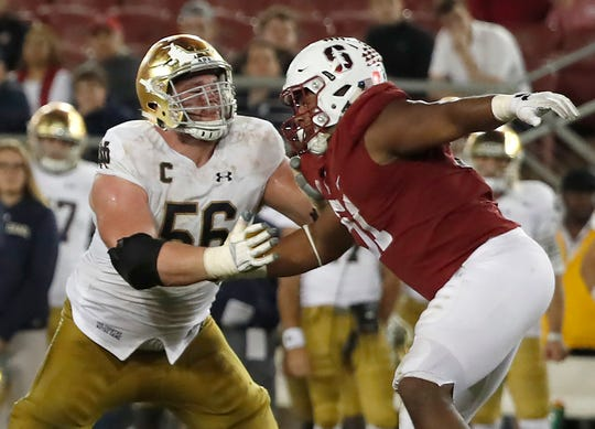 Stanford defensive end Jovan Swann (51) goes up against Quenton Nelson.