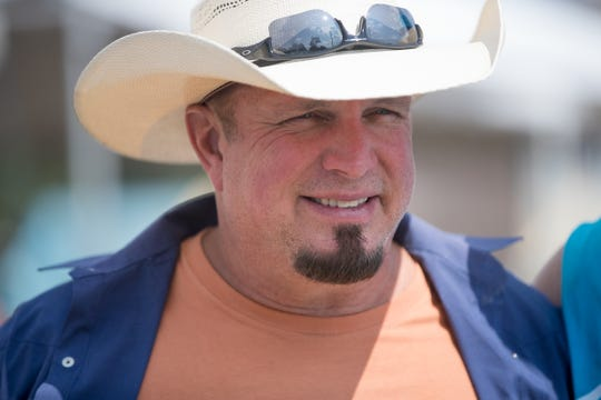 Garth Brooks made an appearance to help the Habitat for Humanity build in Mishawaka, Monday, Aug. 27, 2018. The project is getting the bulk of work done in putting 22 homes up this week for families that will take over affordable mortgages in this all-Habitat neighborhood.