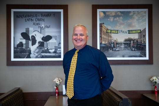 """Chris Spires, owner of the Chick-fil-A located at 2687 E Main St., Plainfield, Ind., poses for a portrait inside his store on Wednesday, Aug. 29, 2018. Spires said the store will soon go through a full remodel to add more kitchen space, refinish the interior of the building and add an extra drive-thru lane. The store will close on Sept. 29, with an estimated reopen date of Nov. 8, 2018. Instead of laying his workers off, Spires will pay them for volunteering in the community. """"We have about 5,000 hours to schedule,"""" he said."""
