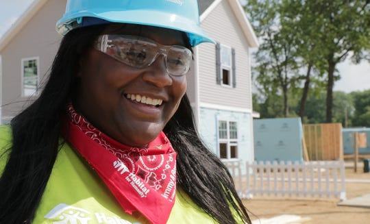 CleoraTaylor's new home is being built by Jimmy Carter and other volunteers from the Habitat for Humanity group working in Mishawaka, Tuesday, Aug. 28, 2018. The project is getting the bulk of work done in putting 22 homes up this week for families that will take over affordable mortgages in this neighborhood that's one of the Jimmy and Rosalynn Carter Work Projects.