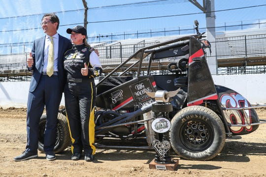 Doug Boles and Sarah Fisher posed for photos with her midget car last week.