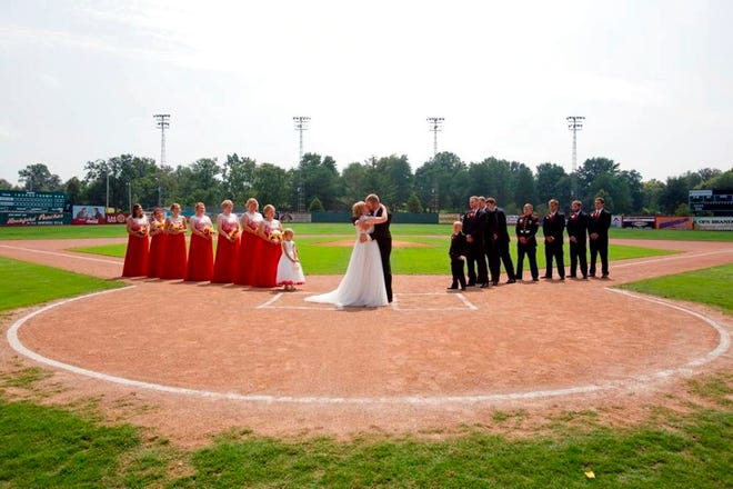 """Kristopher Weisheit and Brittany Birk took their vows Saturday, Aug. 25, 2018,  from home plate at League Stadium in Huntingburg, Ind., while their groomsmen and bridesmaids lined up, respectively, along the first and third baselines. The stadium is featured in the 1992 movie about a women's baseball league during World War II that starred Tom Hanks and Madonna. In one scene, Hanks' team manager character tells one of his players: """"there's no crying in baseball."""""""
