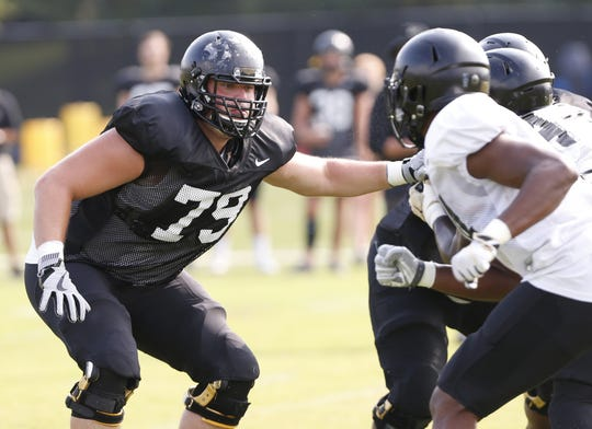 Offensive lineman Matt McCann blocks during scrimmage at Purdue football practice, August 10, 2018, in West Lafayette.