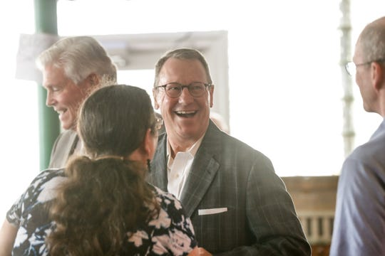 "Kevin Betz chats with party guests during the a private Workingman's Friend 100th birthday party, held as part of an annual party by Betz & Blevins Litigation and Employment Law to celebrate ""Hard working Hoosiers for Labor Day,"" at the Workingman's Friend in Indianapolis on Wednesday, Aug. 29, 2018."