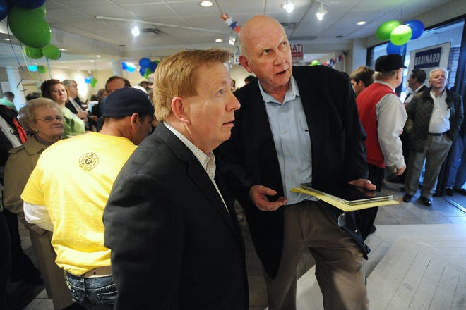 Carmel Mayor Jim Brainard, left, and political strategist Allan R. Sutherlin, look at incoming results of Carmel primary races Tuesday May 3, 2011.