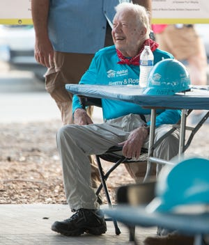 President Jimmy Carter smiles during morning remarks at a Habitat for Humanity build in Mishawaka, Tuesday, Aug. 28, 2018. The project is getting the bulk of work done in putting 22 homes up this week for families that will take over affordable mortgages in this neighborhood that's one of the Jimmy and Rosalynn Carter Work Projects.