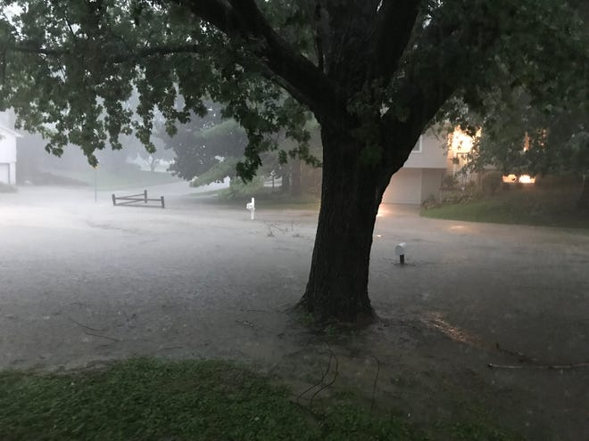 Spot flash flooding is shown near the intersection of Weeber Street and Weeber Circle in Iowa City on the night of Tuesday, Aug. 28.