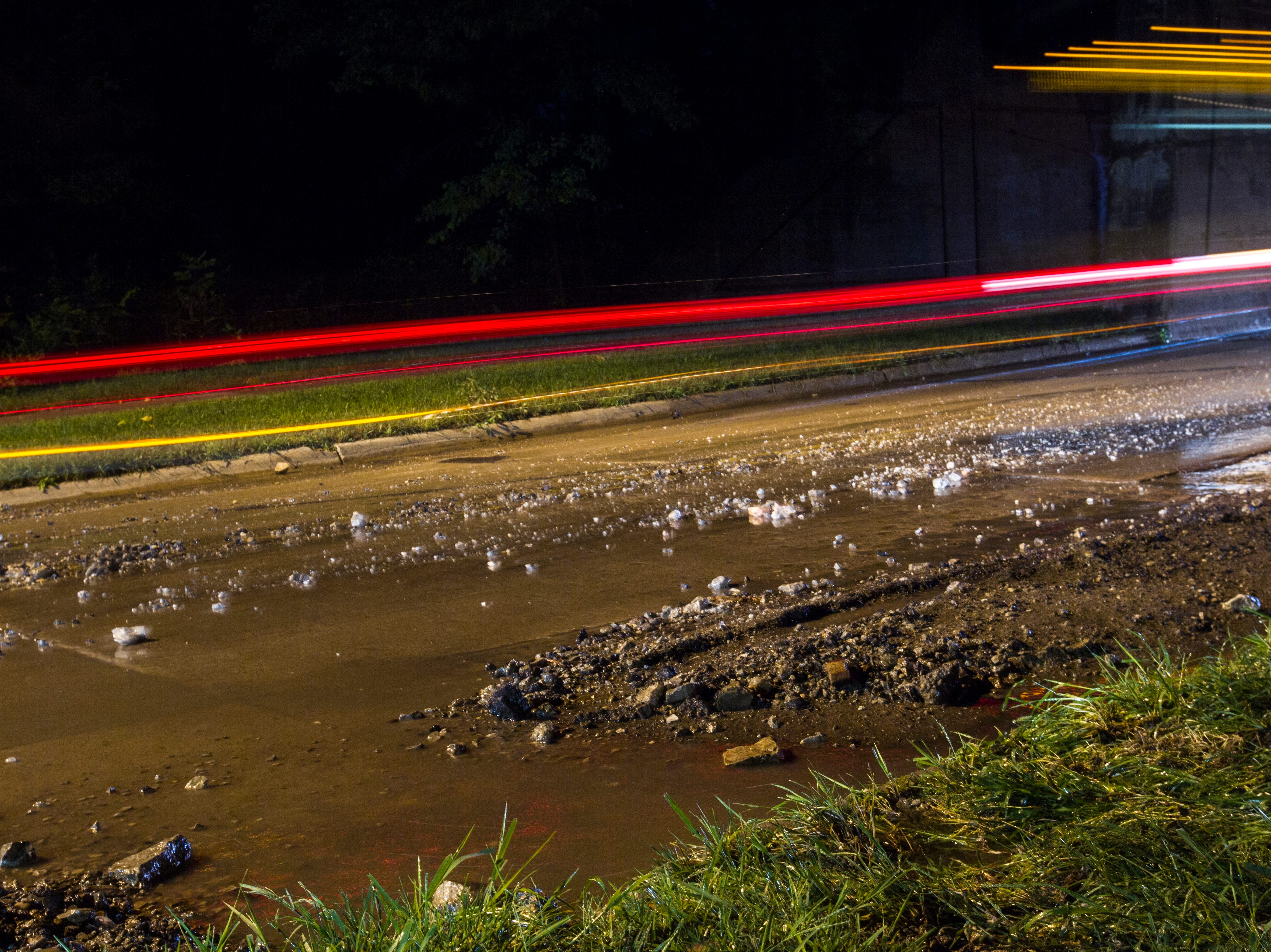 Mud and rocks fill the road during a rain storm on Tuesday, Aug. 28, 2018, on Lower Riverside Drive in Iowa City.