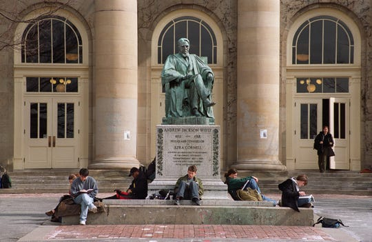 1999: Cornell University students study beside a statue of Andrew Dixon White outside Goldwin Smith Hall. Many university and college tuitions hit record highs this year, including those at Cornell and Ithaca College, but the schools say they are also providing more financial aid.