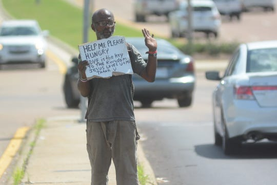 A homeless man asks for help at the intersection of Interstate 55 and Lakeland Drive in Jackson. The ACLU of Mississippi is demanding cities such as Jackson remove ordinances that make panhandling illegal.
