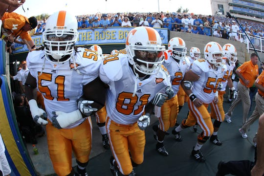 Red flag: Tennessee players head onto the field before playing UCLA on Monday, Sept. 1, 2008, in Pasadena, Calif.