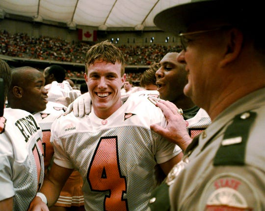 Jeff Hall got hugs and pats on the back from almost every teammate after kicking the game-winner against Syracuse, 1998.