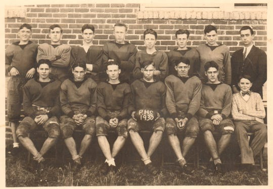 "The 1930 Powell High School football team: front row (from left): Glenn Diehl, Rut Johnson, Woodrow Ward, Cy Roberts, Moss Evans, Woodrow Evans, Paul ""Shorty"" Herrell (manager); back row (from left): Ray Ousley, Keith Nighbert, J. James, Ray Craig, Bill Bayless, Everett Franse, Joe Ivester, Coach Alvin G. Haworth."
