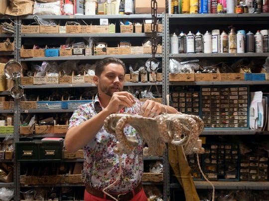 Rod Ledbetter fits lighting to an octopus-shaped chandelier at Calloway's Lamp & Shade on Wednesday, Aug. 22, 2018.