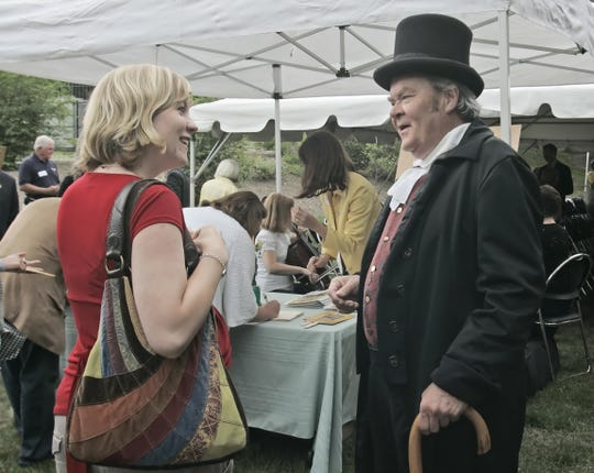 Arliss Jeffries as John Purdue greets   Eileen Booth during  the 140 anniversary celebration for Lafayette Savings Bank in 2009.