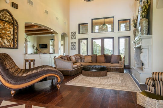 The huge entrance and living areas include gorgeous wood floors and trim work.