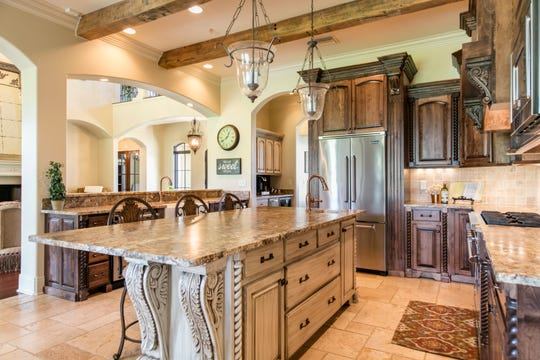 The gourmet kitchen features top of the line everything.