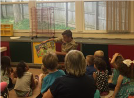 Eric Johnson reading with children at Redeemer Lutheran Childcare.