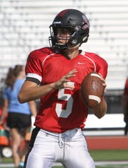 Pinckney quarterback Joe Bona threw for three touchdowns in his varsity debut, leading the Pirates past Tecumseh.