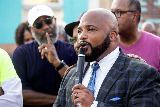 Elim Baptist Church pastor Vincent James speaks about the murder of congregation member Bennie Berry during a prayer service. Aug. 28, 2018
