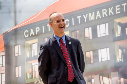 Mayor Andy Schor laughs during an event announcing the planned development of a grocery store and hotel at the 600 block of East Michigan Avenue on Wednesday, Aug. 29, 2018, in downtown Lansing. The project is part of a mixed-use developmentÊslated to open by theÊend of 2020.
