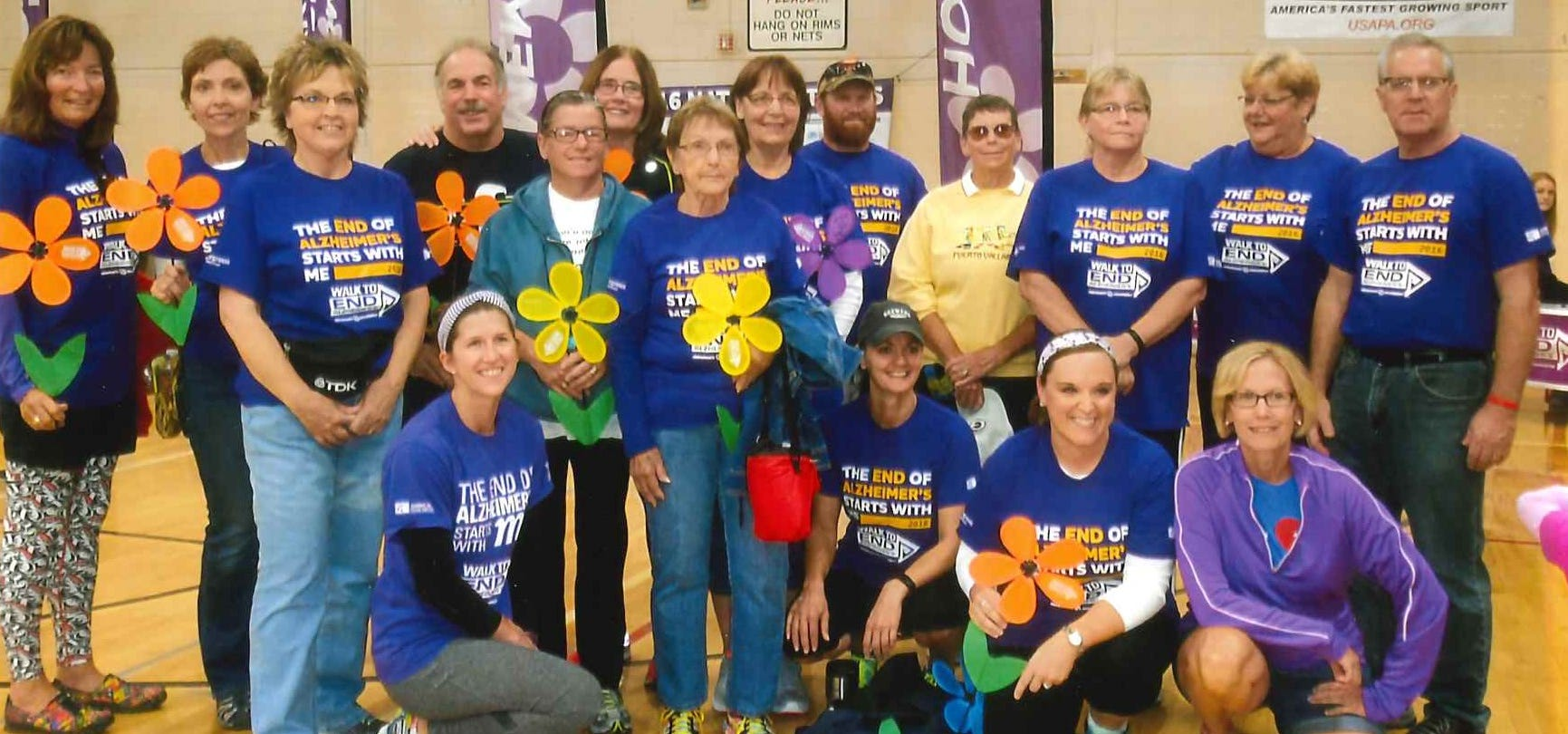 """Paul Jagemann's Walk to End Alzheimer's team, """"Paul's Posse,"""" in September 2016, the year before he died. The team was the top fundraising team that year. Paul is far right, his wife Nan is left with light jeans, daughter Erin is kneeling second from right with her husband, Robin, in the back row wearing sunglasses and hat. Son Tony was unable to attend the walk that year."""