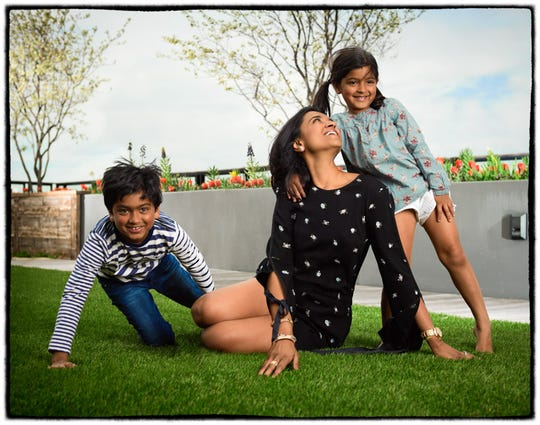 Purvi Padia plays with her children, son Rehen, 10, and daughter Reven, 6.