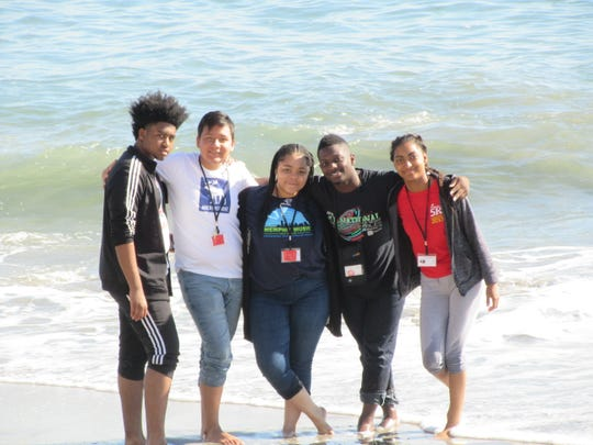 From left, Tavian Williams, Jose Ayala, Allyson Smith, ZaVon Glass and Alicia Taylor on a beach in South Africa.