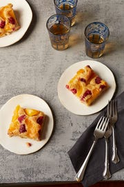 Whole-Grain Sunken Peach and Raspberry Cake is a variation of the traditional honey apple cake for Rosh Hashanah.