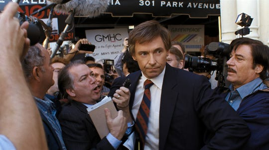"Presidential candidate Gary Hart (Hugh Jackman) meets the press in ""The Front Runner."""