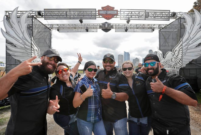 Joseyos Fiallo (from left), May Savignon, Marta Ledezma, David Ledezma, Wendy Miranda and Jamner Moreno, all from Miami, relax after a three-day ride from their hometown to Milwaukee. They gathered as riders started to pour into Milwaukee for Harley-Davidson's 115th anniversary kickoff celebration at Veterans Park at the lakefront.