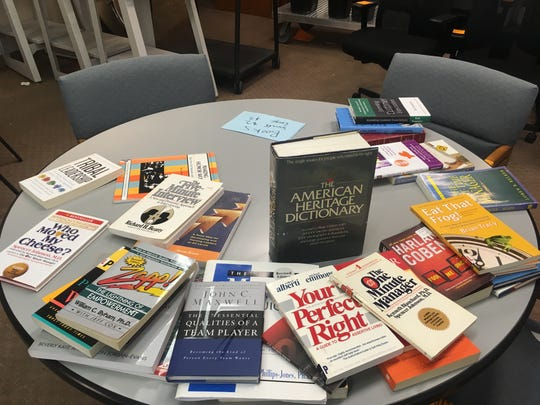 Books on business and management were for sale in a room at the Grand Avenue mall where used furnishings and items from Bon-Ton Stores Inc.'s Milwaukee corporate offices were sold as part of the bankrupt retailer's going-out-of-business sale.