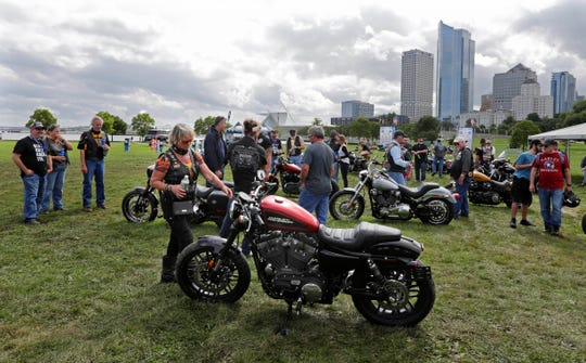 Harley-Davidson fans check out a Roadster on display at Veterans Park at the lakefront during Harley's 115th anniversary party.