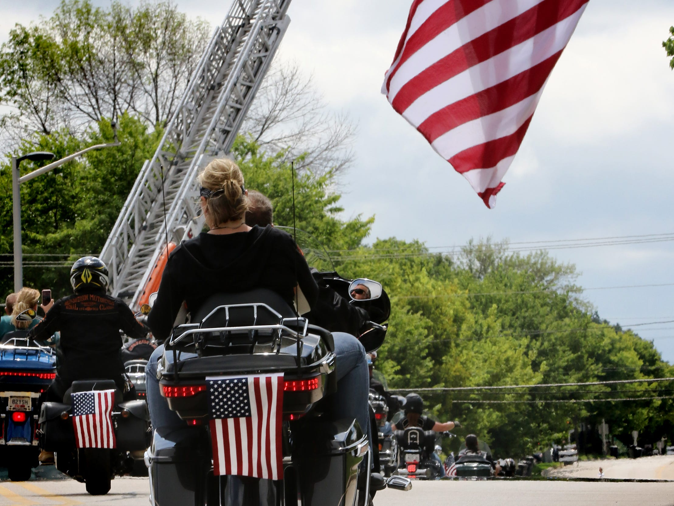 Harley enthusiasts roll south on 60th Street from the House of Harley-Davidson on Wednesday on a charity ride benefiting the Wisconsin Veterans Network though southern Milwaukee County communities to Veterans Park on the Milwaukee lakefront.